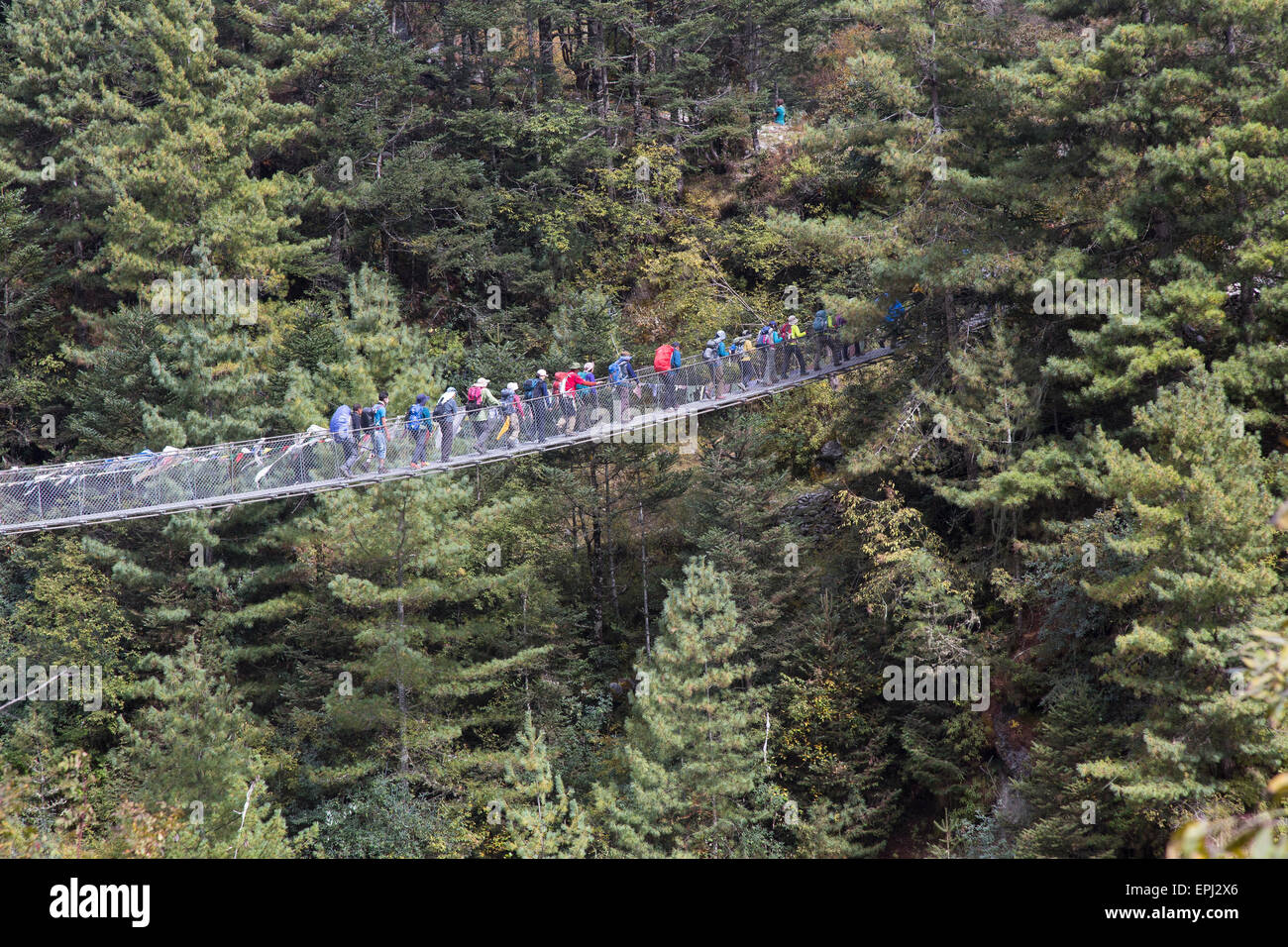 The Everest Base Camp trek crosses the Dudh Kosi River over new wire suspension bridges on the way to Namche Bazaar, - Stock Image