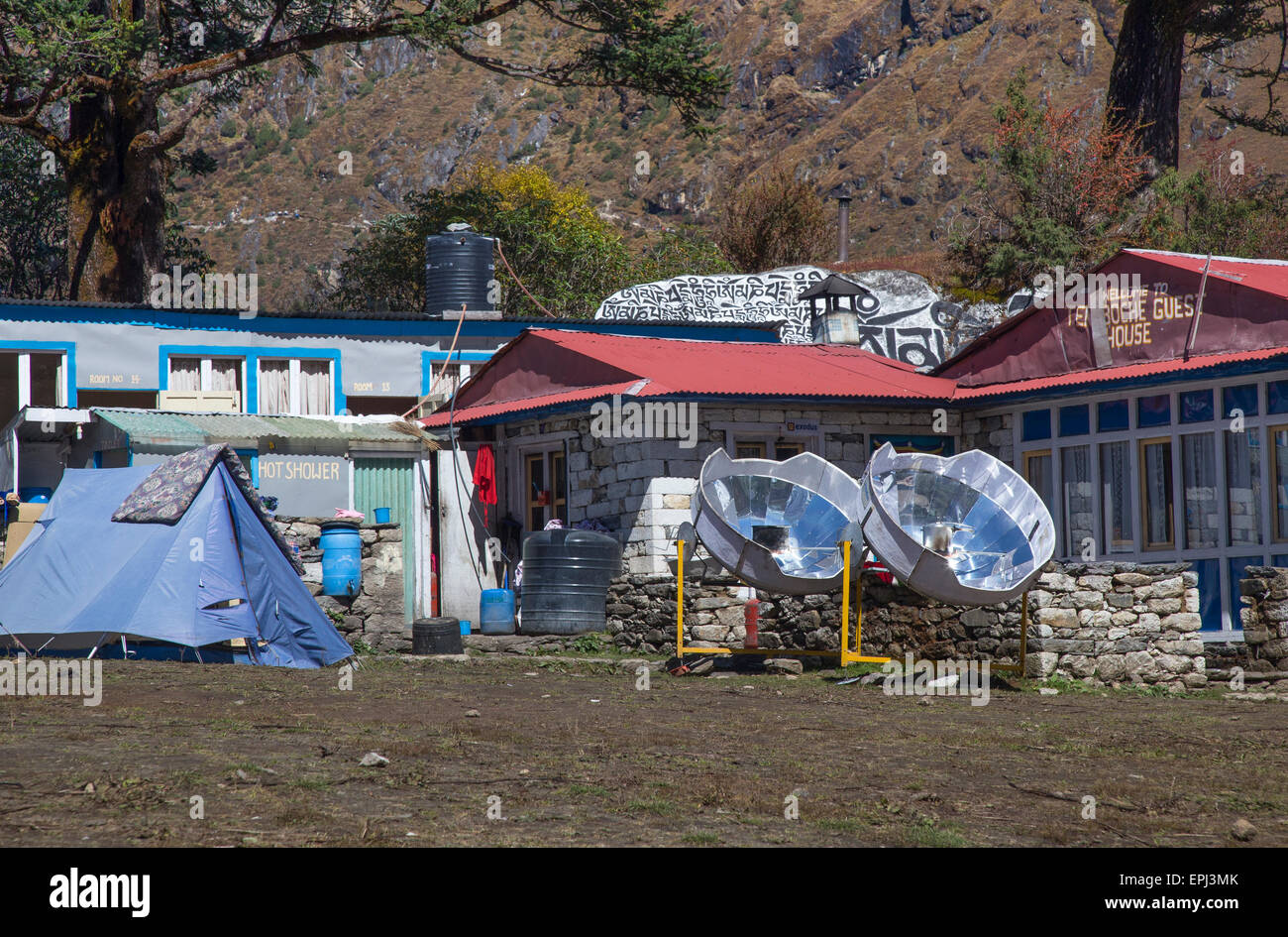 Two solar cookers outside trekking lodges at the monastery in Tengboche, Everest Region Nepal - Stock Image