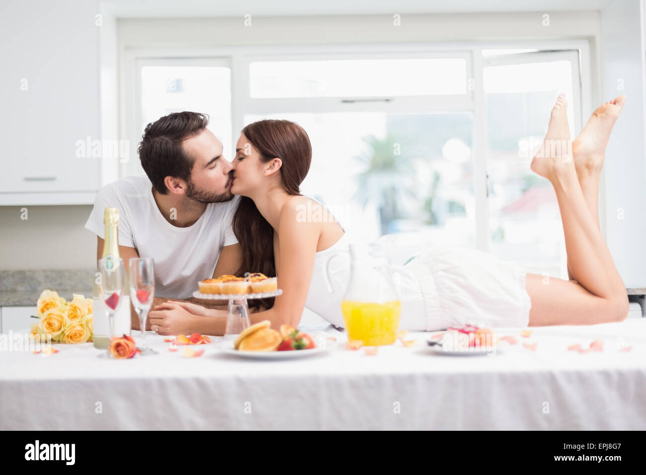 Young couple having a romantic breakfast - Stock Image