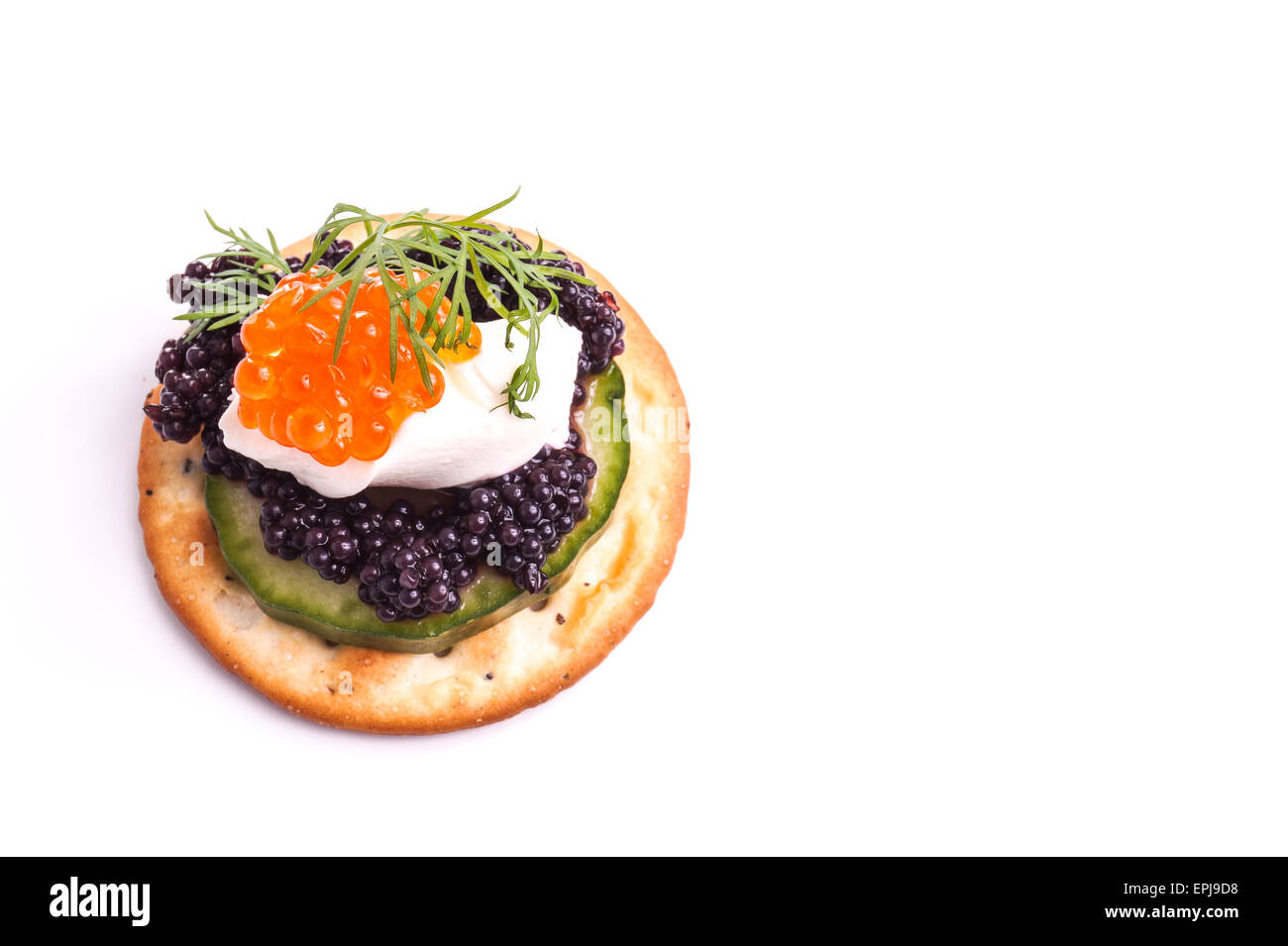 Caviar Appetizer served on crackers isolated on white - Stock Image
