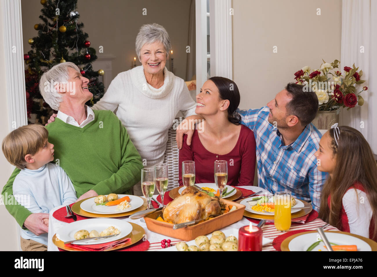 Happy family posing and looking the grandmother - Stock Image