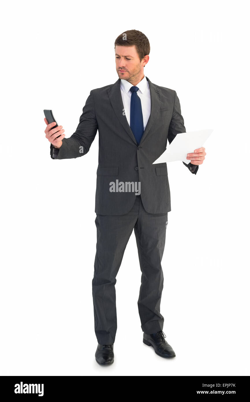 Businessman sending text holding page - Stock Image