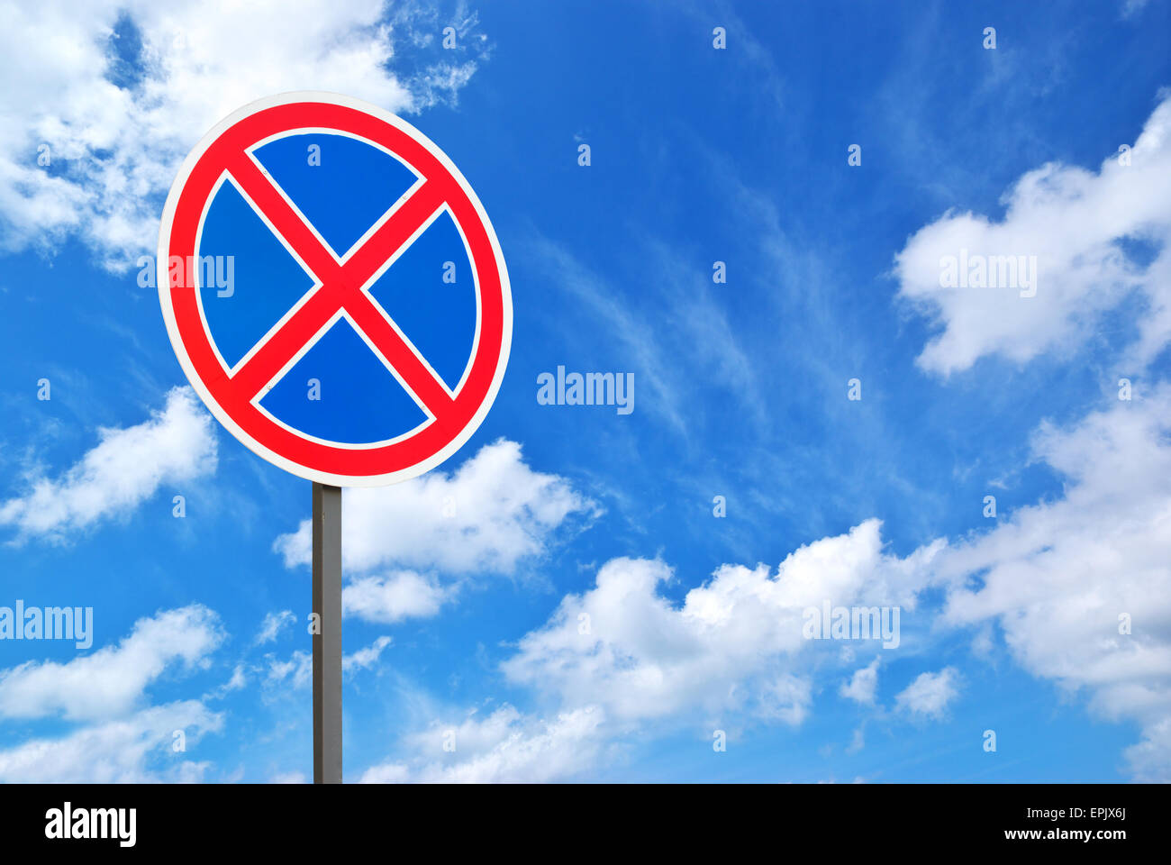 Road sign and blue sky. Isolated design. Stock Photo