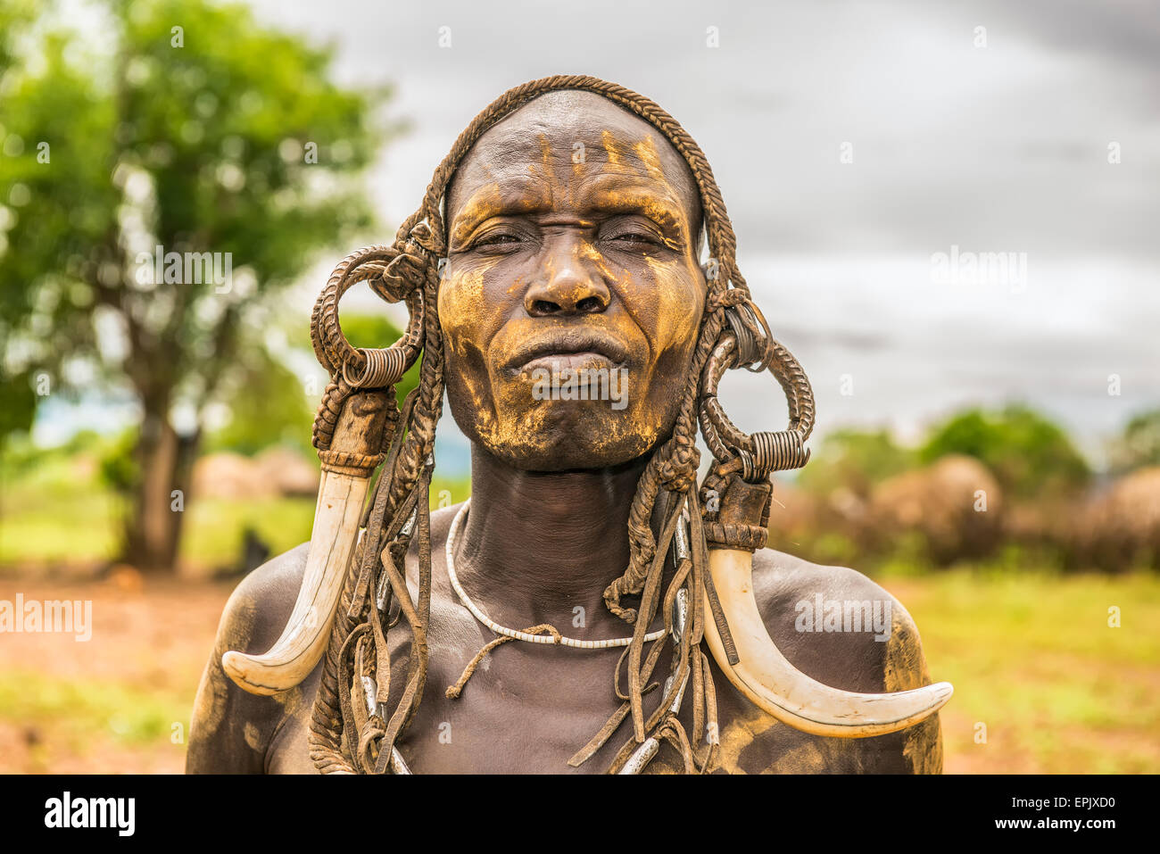Warrior from the african tribe Mursi with traditional horns in Mago National Park, Ethiopia - Stock Image