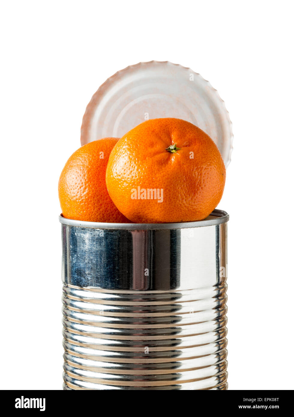 Oranges bursting out of tin can - Stock Image