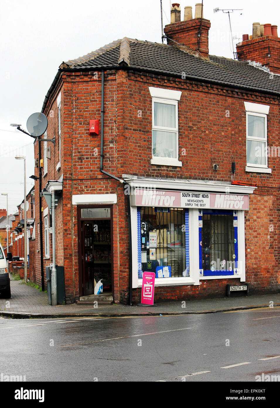 A street corner newsagent's shop on South Street in Crewe in Cheshire England. - Stock Image