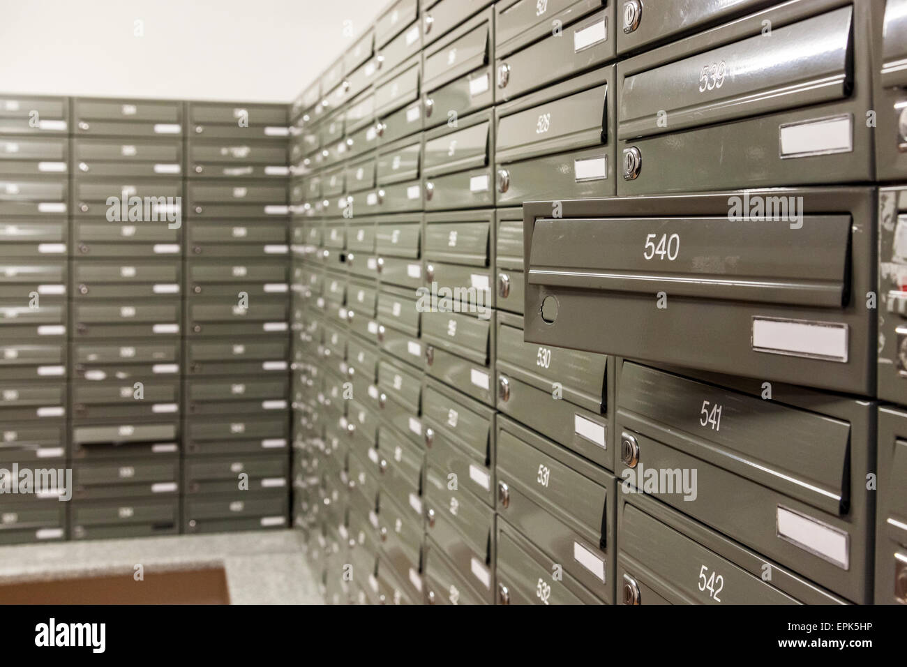Mailboxes in the mailroom of an apartment block, Nottingham, England, UK Stock Photo