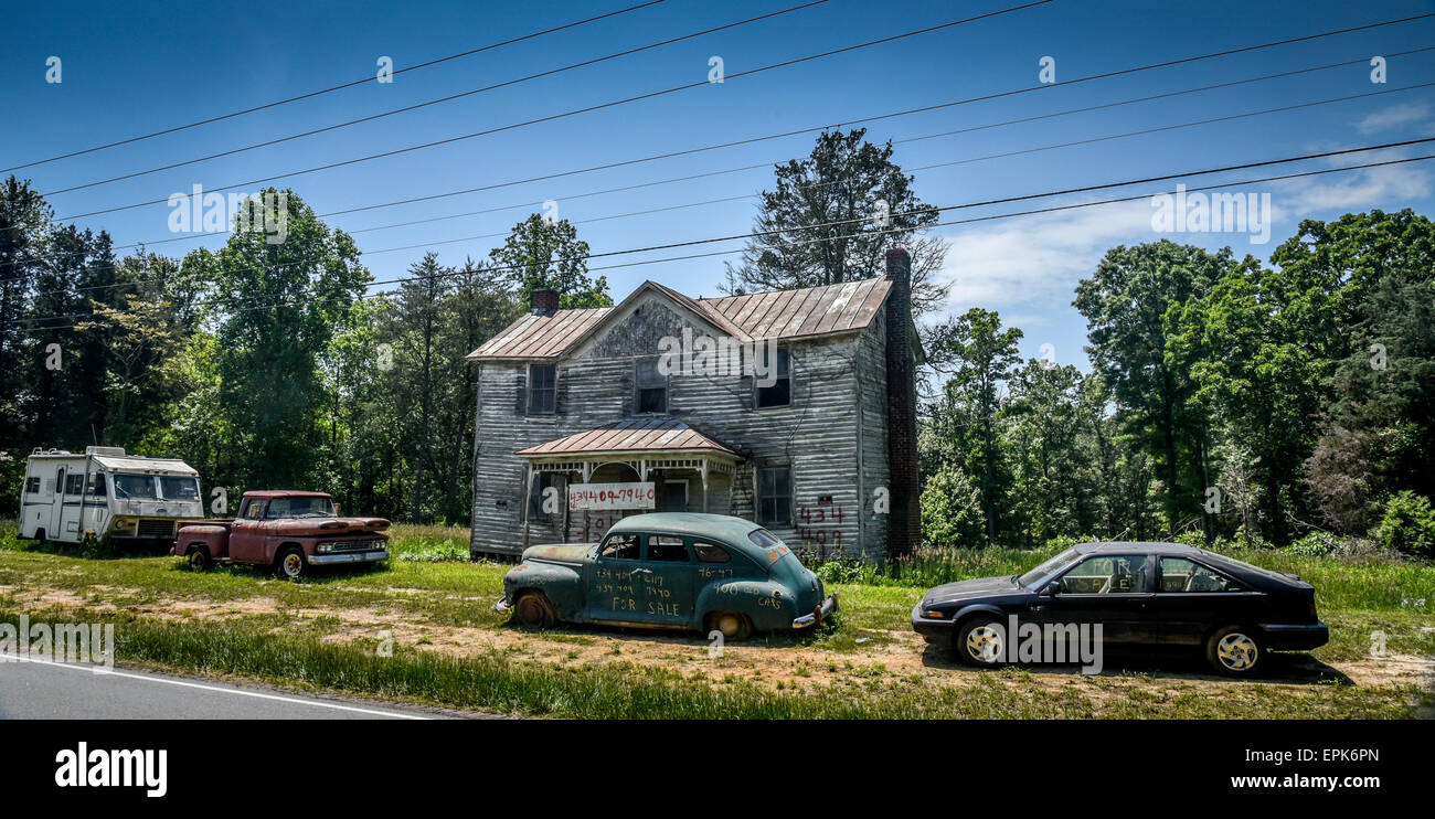 Abandoned House and Cars - Stock Image