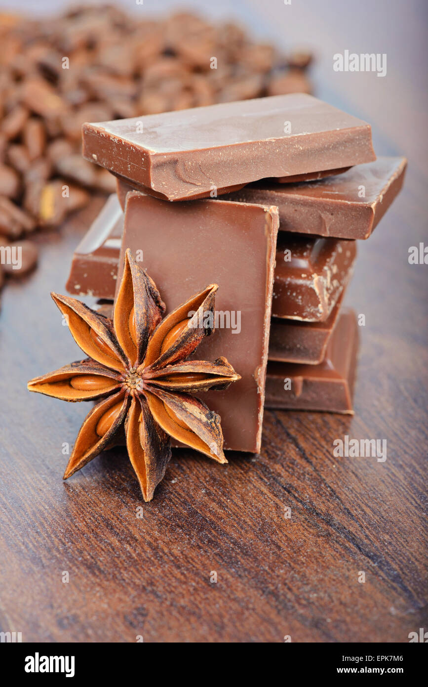 The milk chocolate, coffee beans and anise - Stock Image