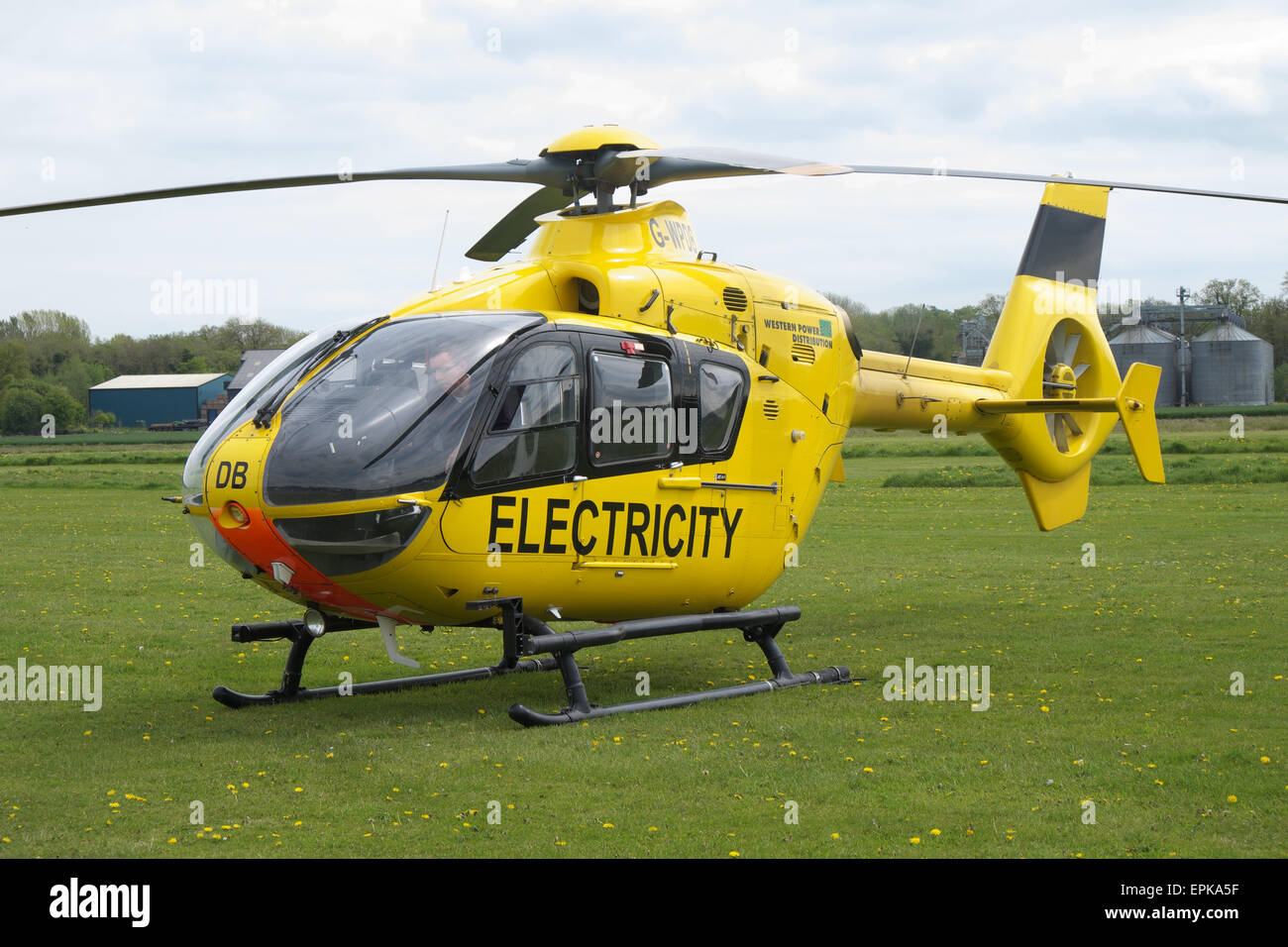 WPD Western Power Distribution EC135 helicopter used to check electricity power supply wires lines and pylons in Stock Photo