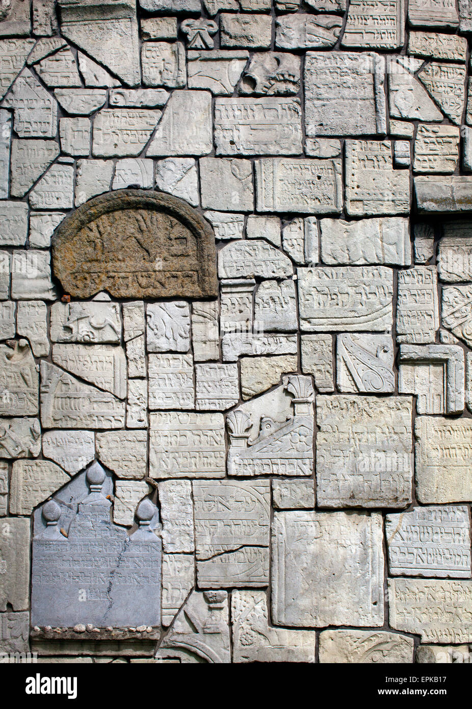 A wall made from gravestones desecrated by the Nazis in Remuh synagogue and cemetery in Krakow - Stock Image
