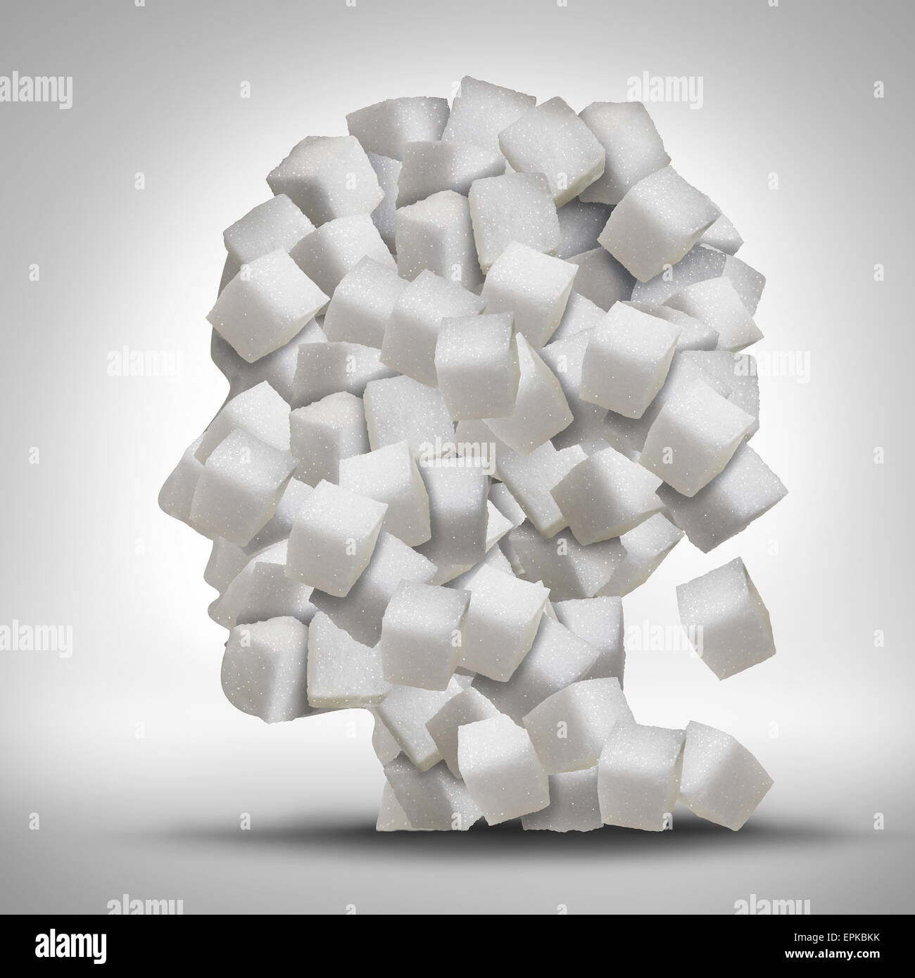 Sugar addiction concept as a human head made of white granulated refined sweet cubes as a health care symbol for - Stock Image