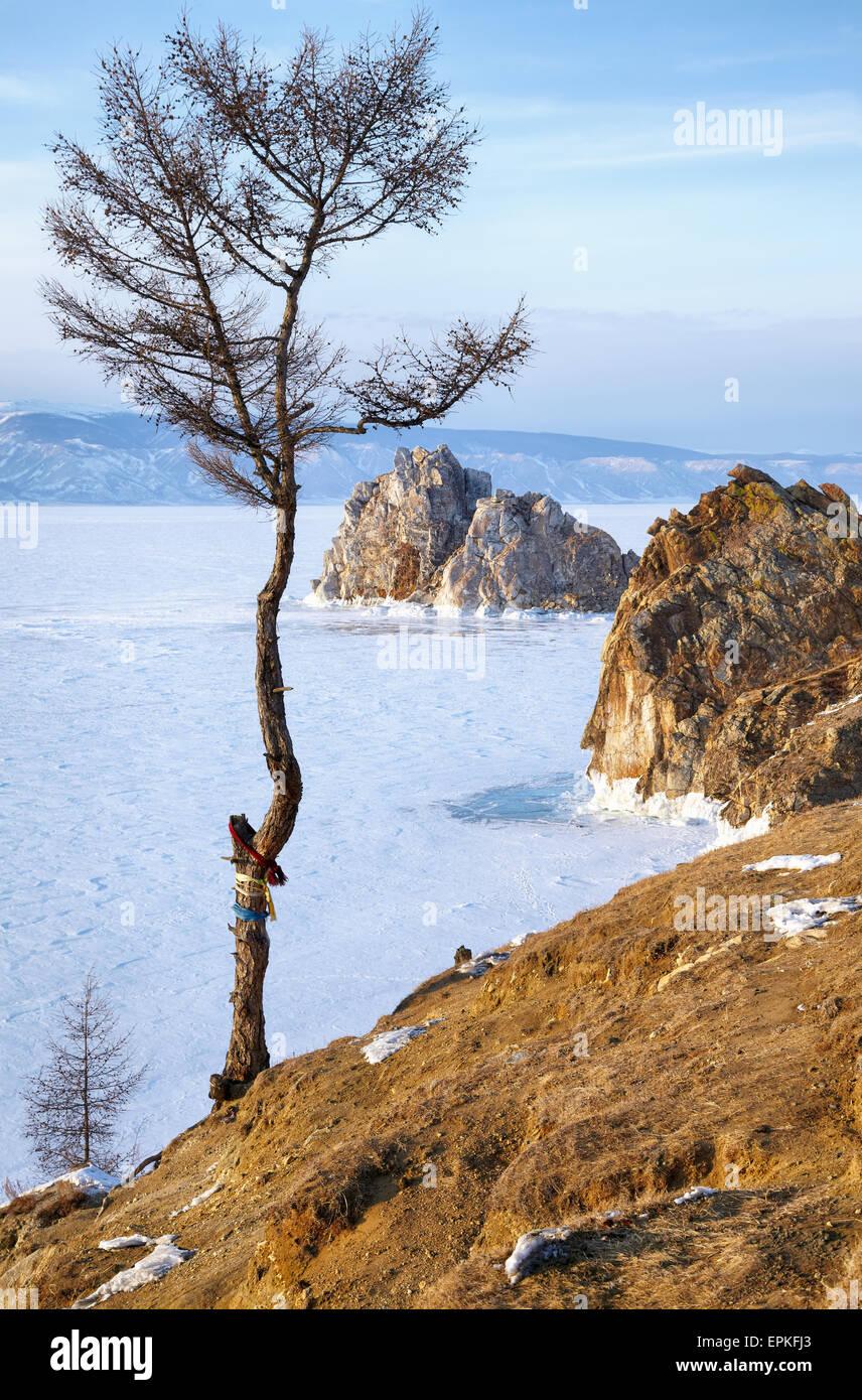 Rock Shamanka on Olkhon island in lake Baikal in winter - Stock Image