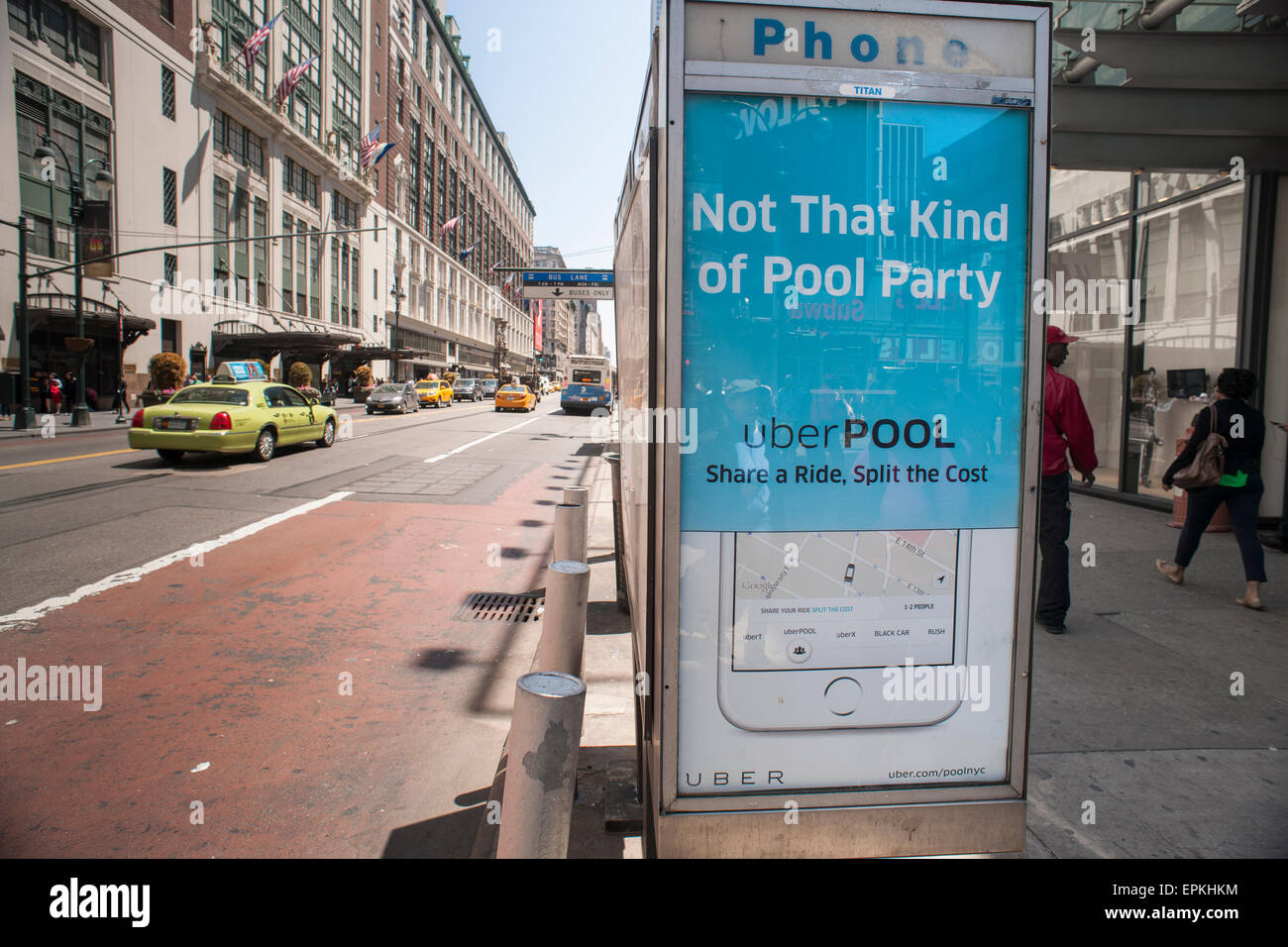 An advertisement on a telephone kiosk for UberPool ridesharing in Midtown in New York on Thursday, May 14, 2015. - Stock Image