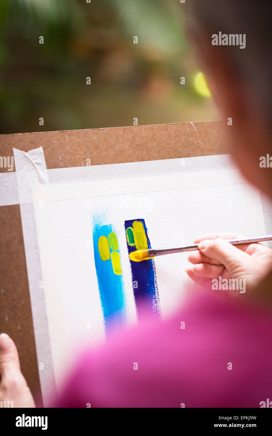 Woman painting an abstract picture - Stock Image