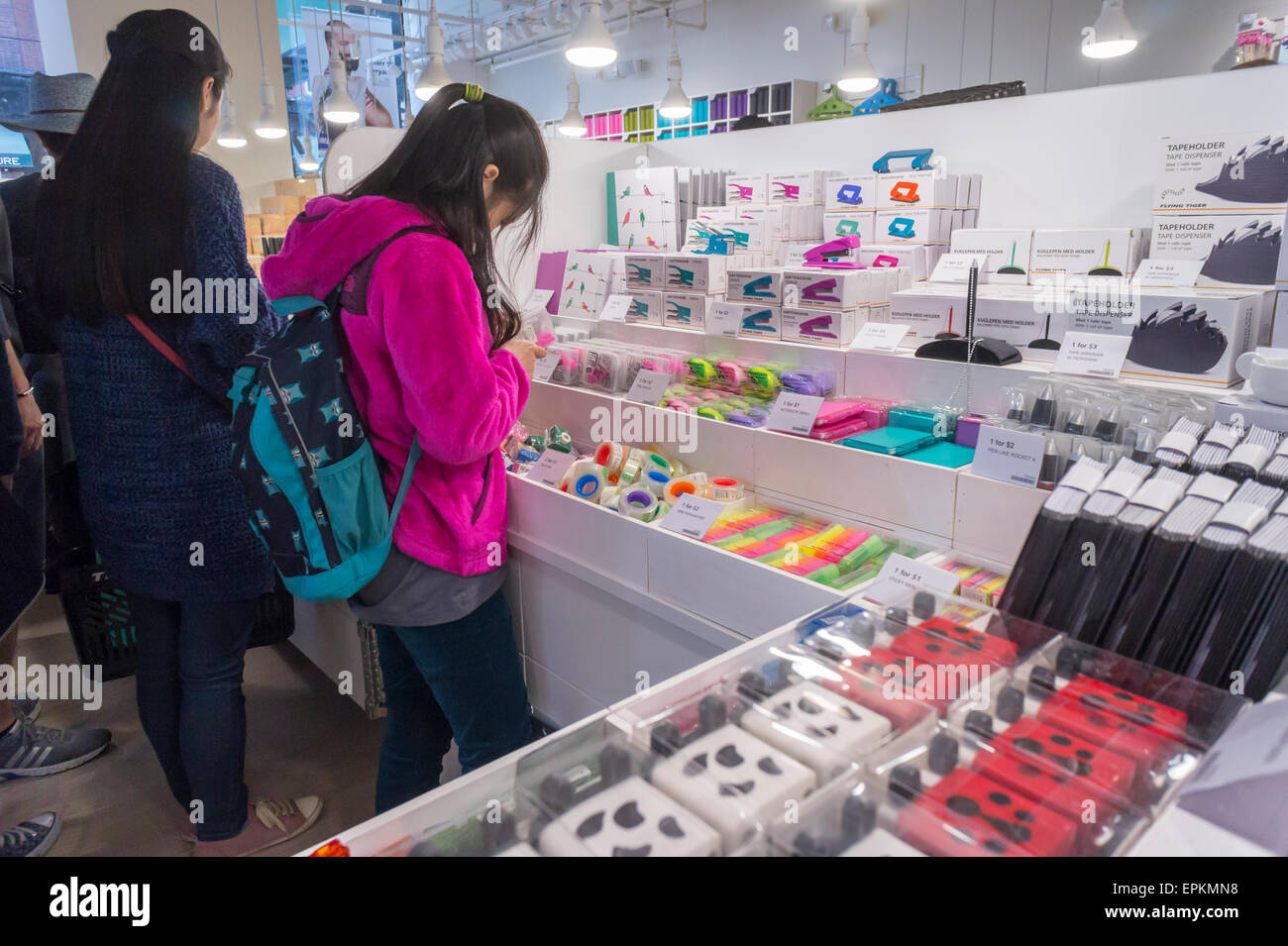Shoppers in the design store Flying Tiger Copenhagen on opening day in the Flatiron District in New York on Saturday, - Stock Image