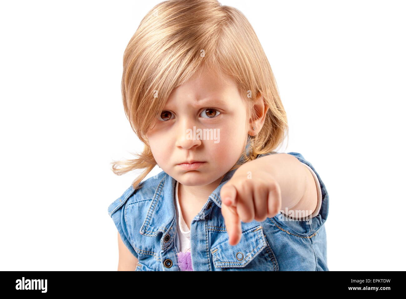 Portrait of a young angry girl pointing up - Stock Image