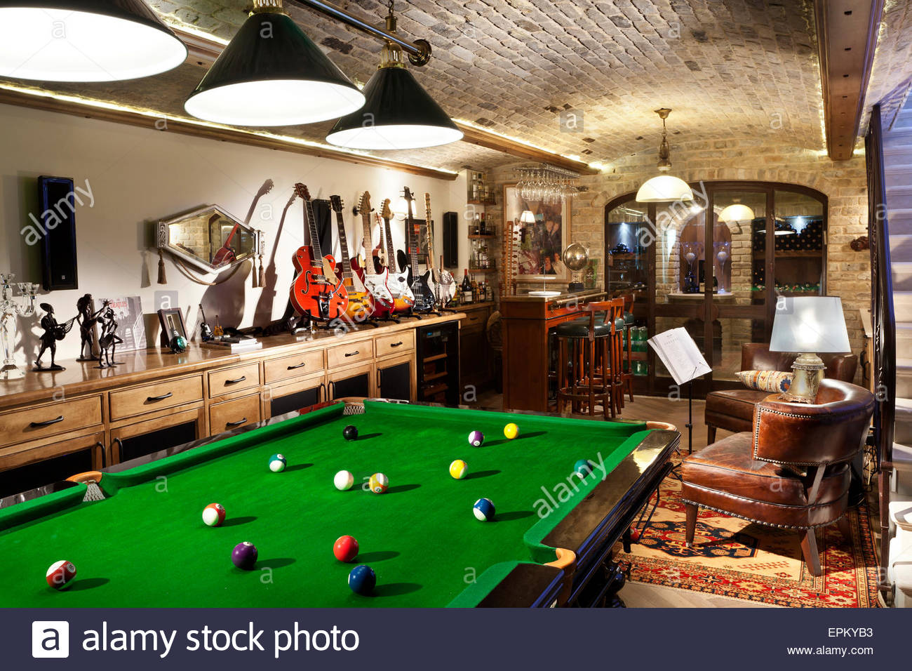 Games room with pool table, bar and electric guitar collection in country villa, Moshav Bnaya, Israel. - Stock Image