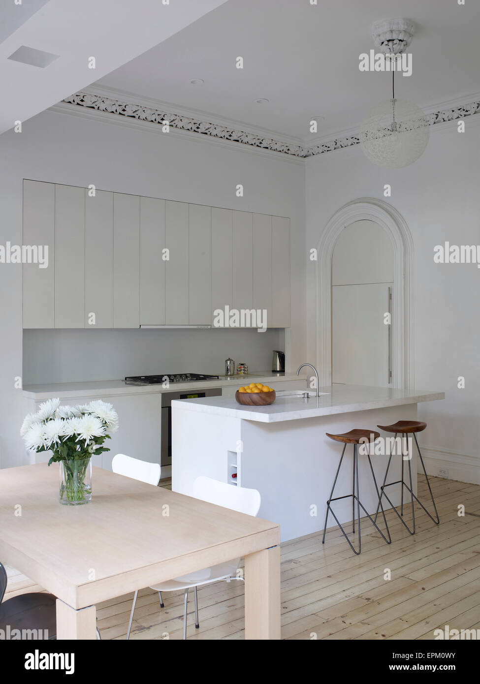 Small dining table, breakfast bar and stools in white kitchen ...