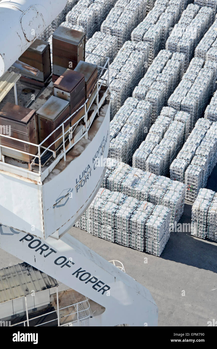 Port of Koper view from dock crane looking down on stacks of aluminium ingots on quayside awaiting loading - Stock Image