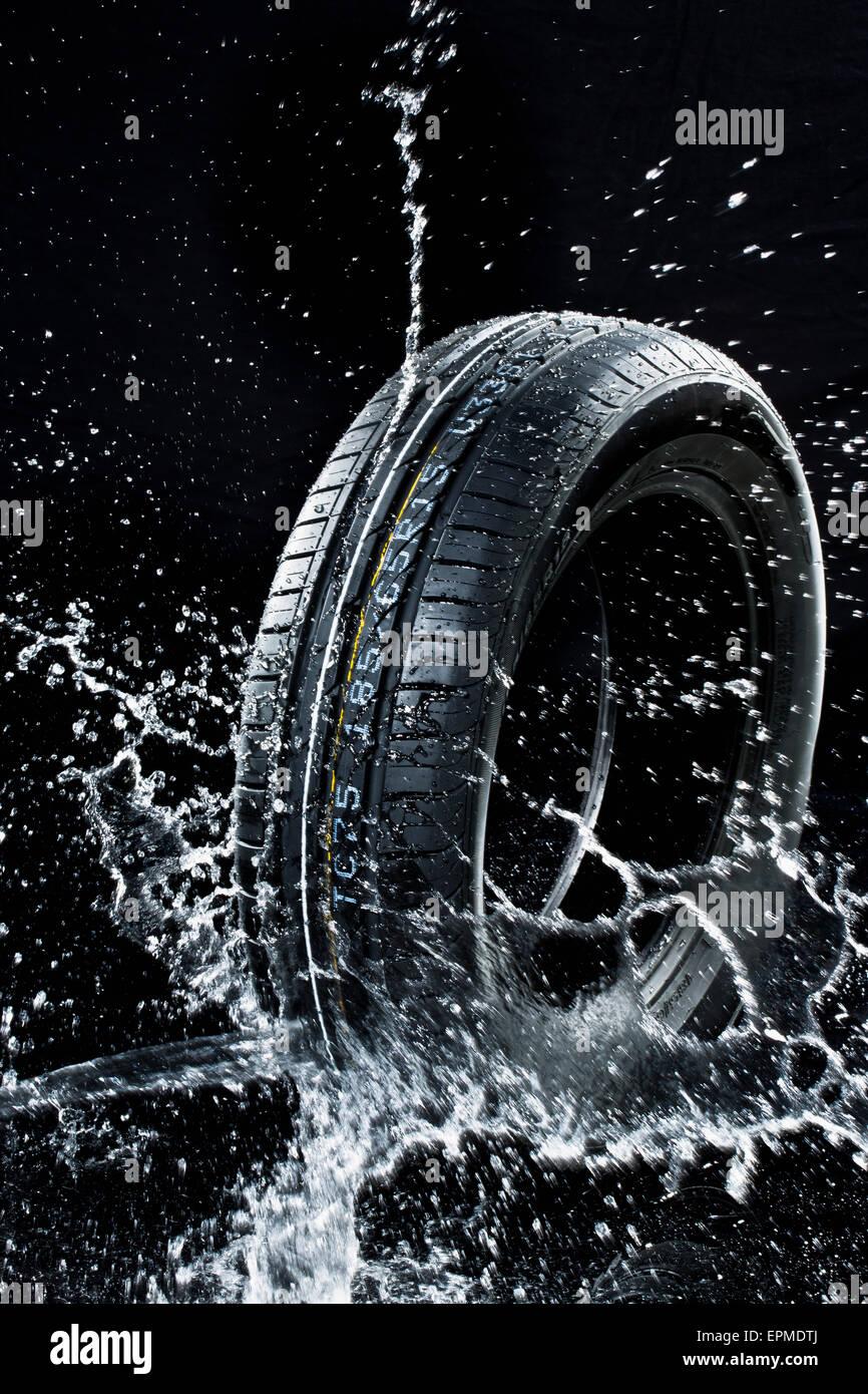 Car tyre in wetness - Stock Image