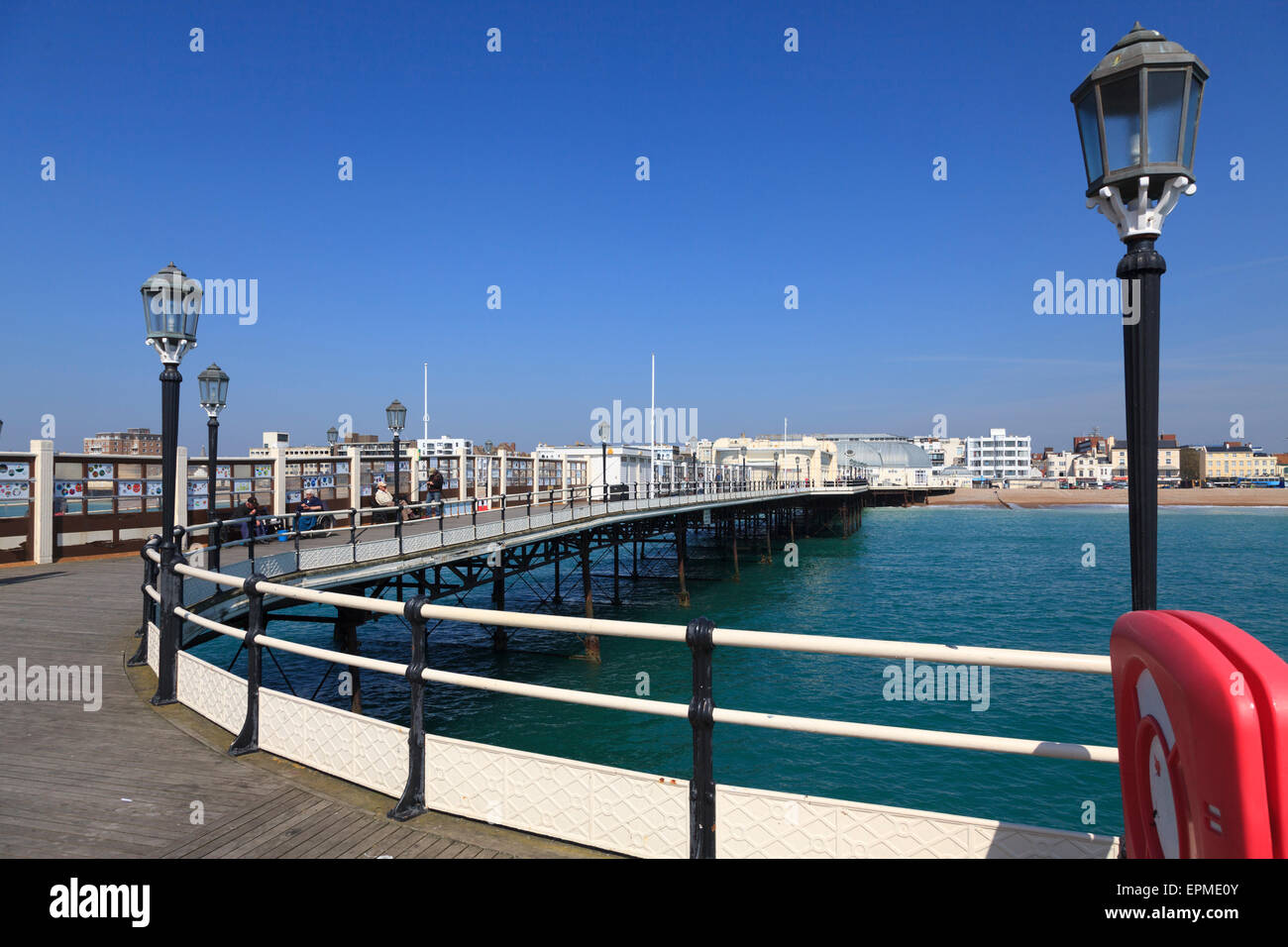 Lifebuoy cabinet and lights on Worthing pier in daylight Stock Photo