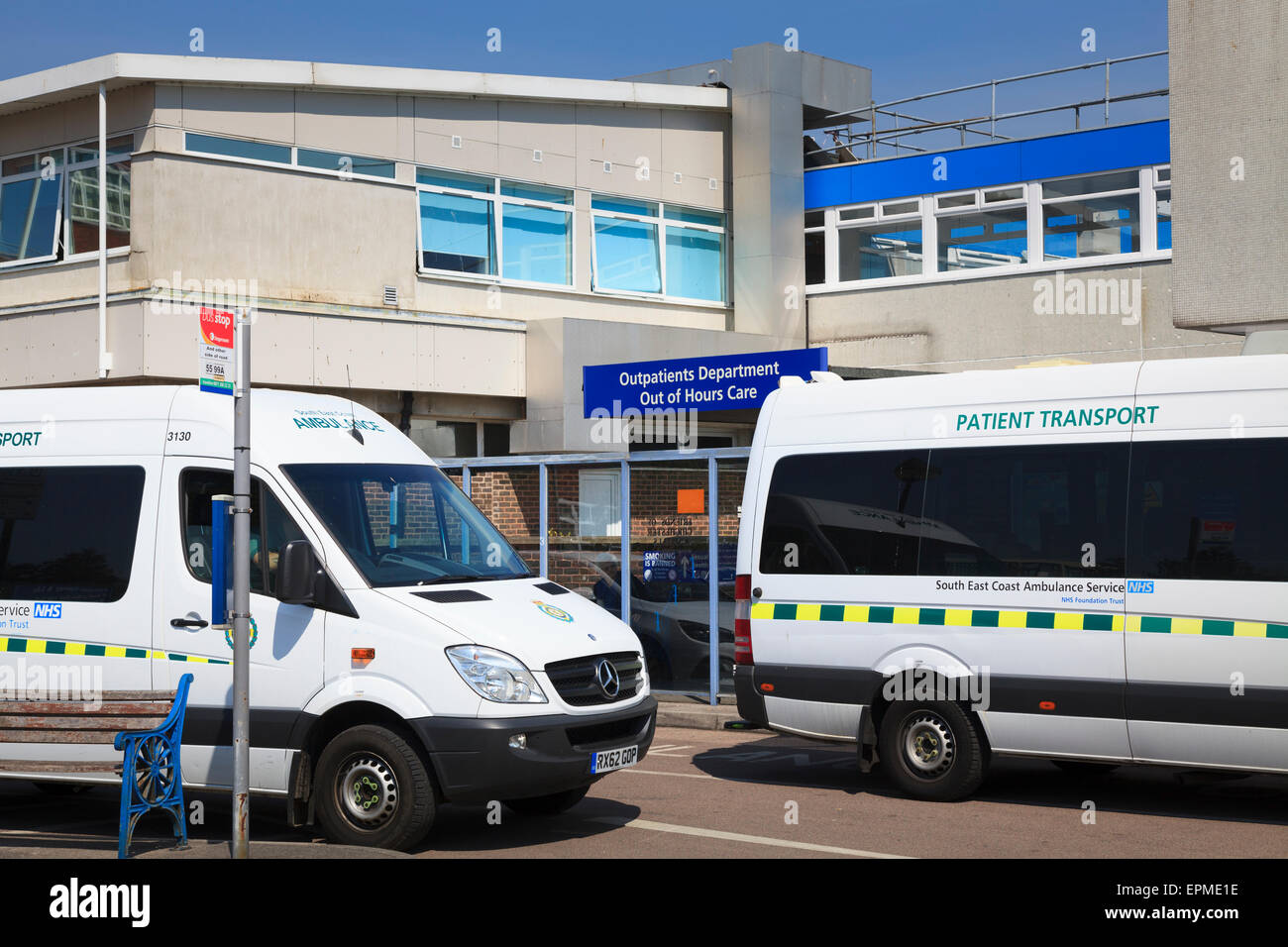 Patient Transport vehicles outside Outpatients Department entrance of St Richards Hospital Chichester - Stock Image