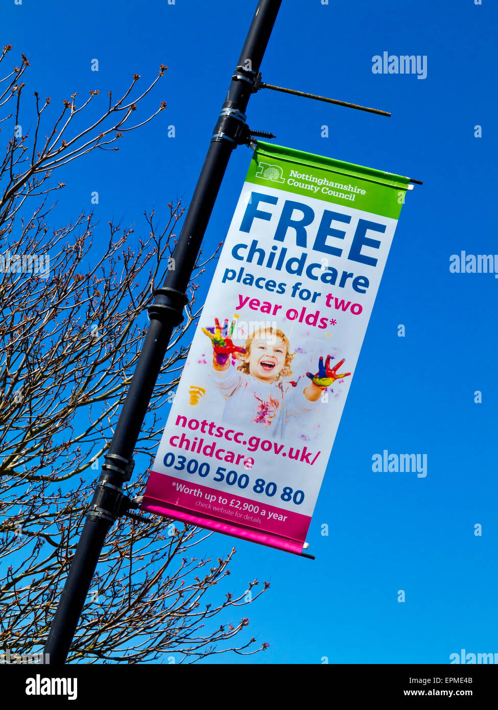 Nottinghamshire County Council Free childcare places for two year olds banner on a lamp post in Newark on Trent - Stock Image