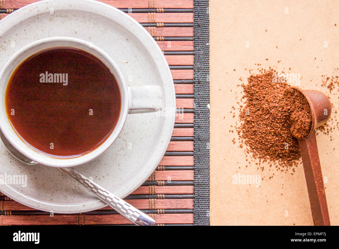 Flavourful dark coffee and minced coffe beans - Stock Image