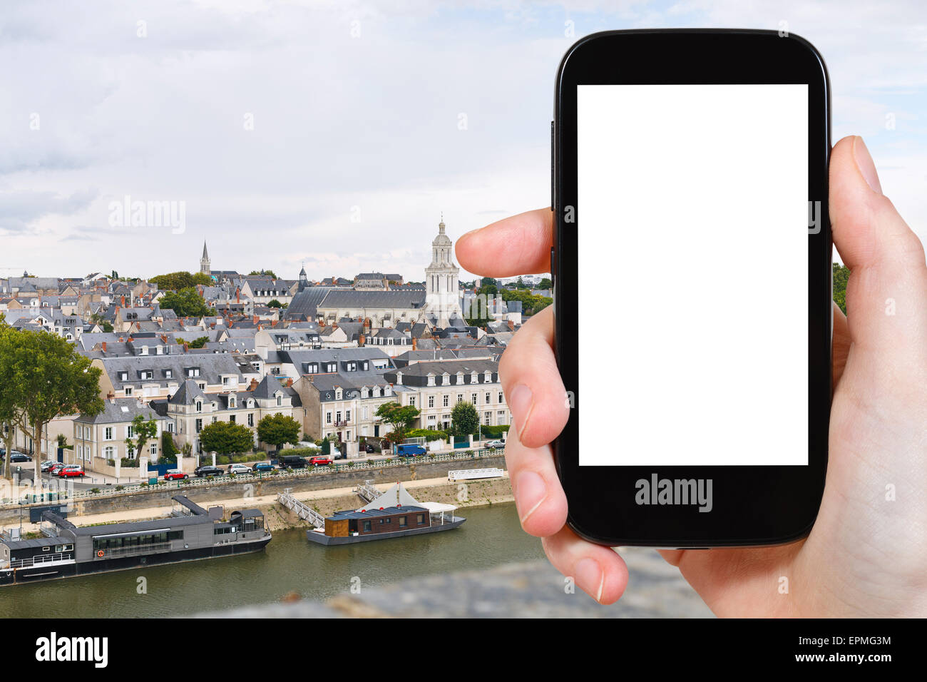 travel concept - tourist photograph quay des Carmes in Anges, France on smartphone with cut out screen with blank - Stock Image