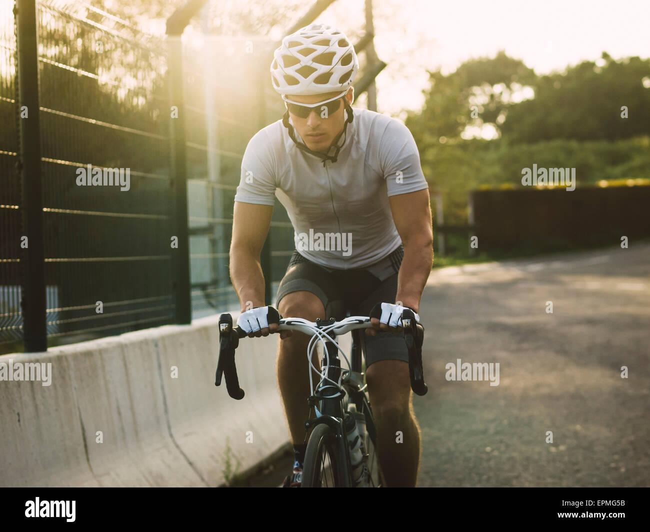 Racing biker at backlight - Stock Image