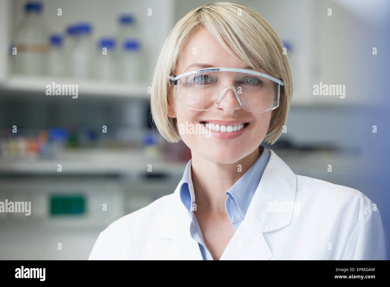 Portrait of smiling scientist in laboratory - Stock Image