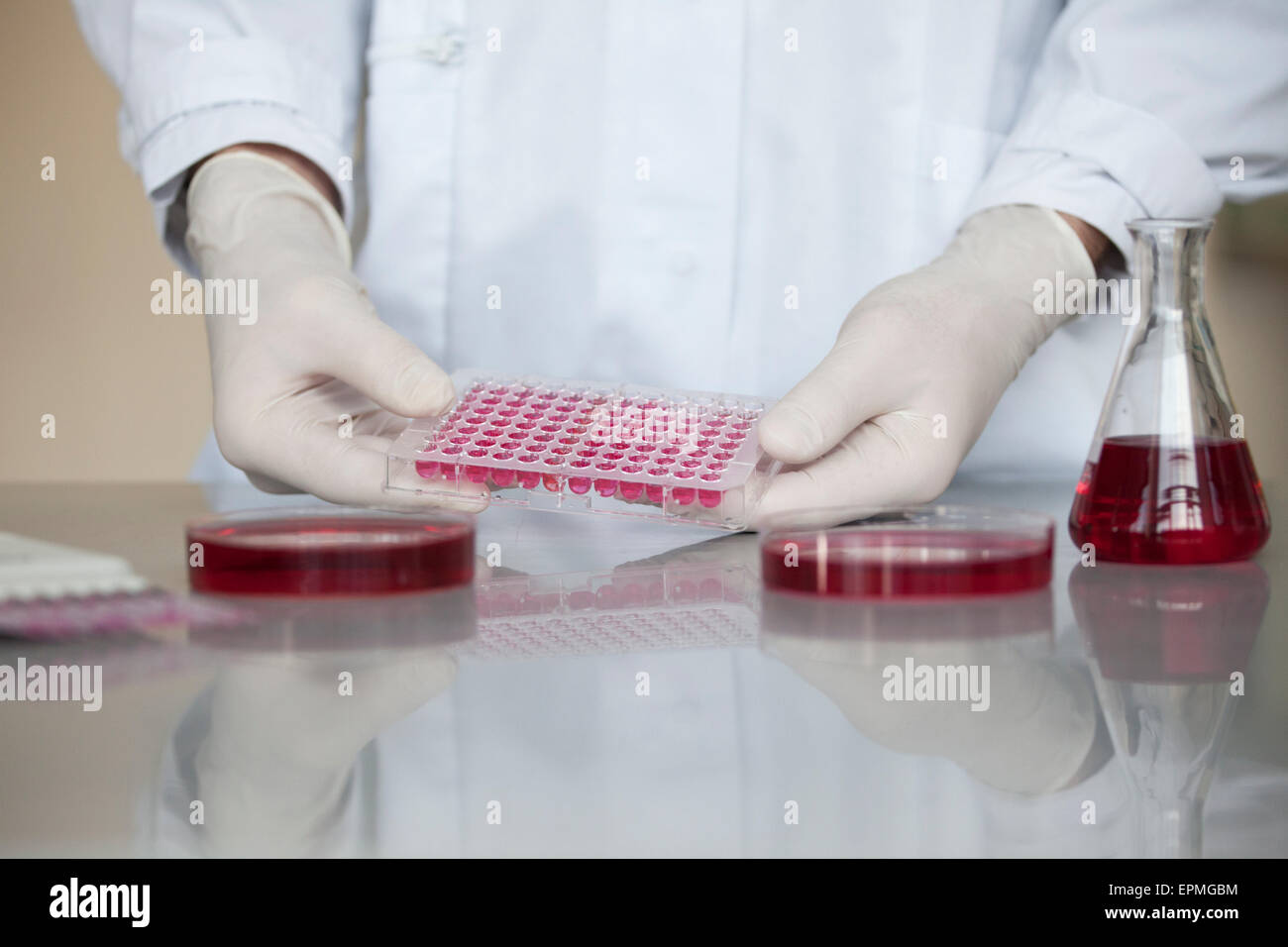 Scientist with liquid in test tubes - Stock Image