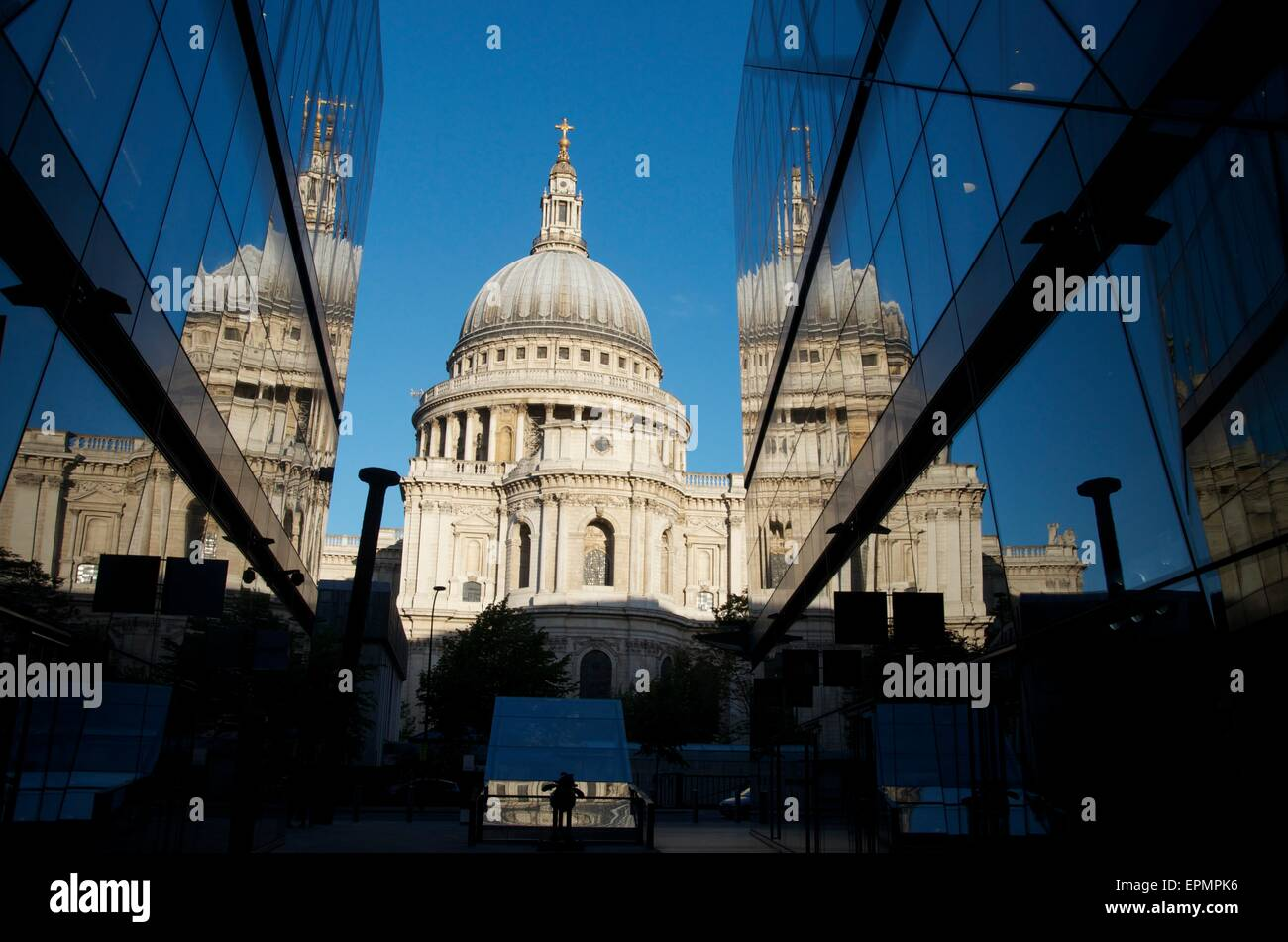 St Paul's Cathedral at Sunrise Reflected in One New Change, The City, London, England, UK - Stock Image