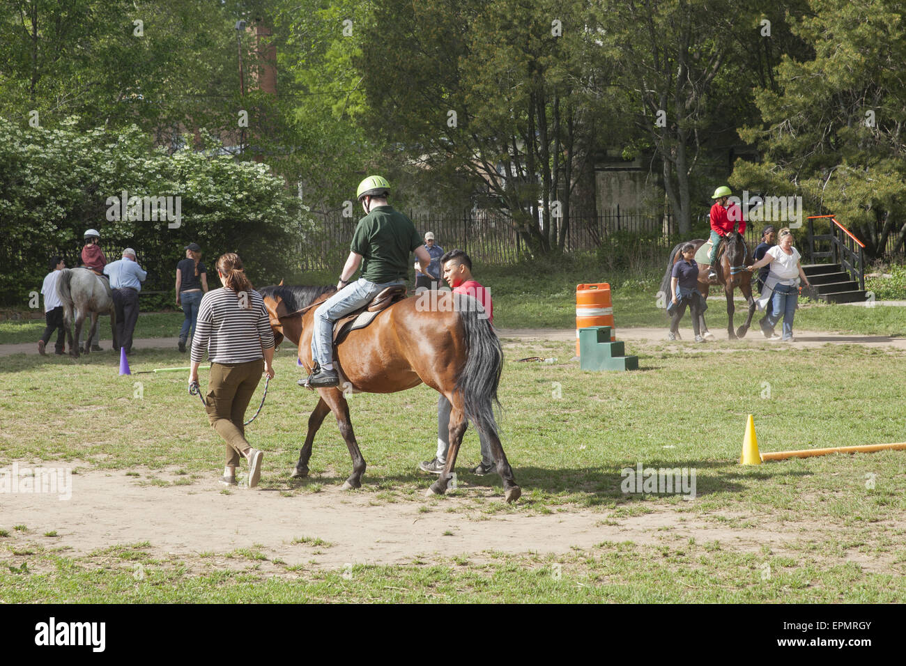 Disabled children receive developmental therapy learning to ride horses, known as Hippotherapy. Prospect Park, Brooklyn, - Stock Image