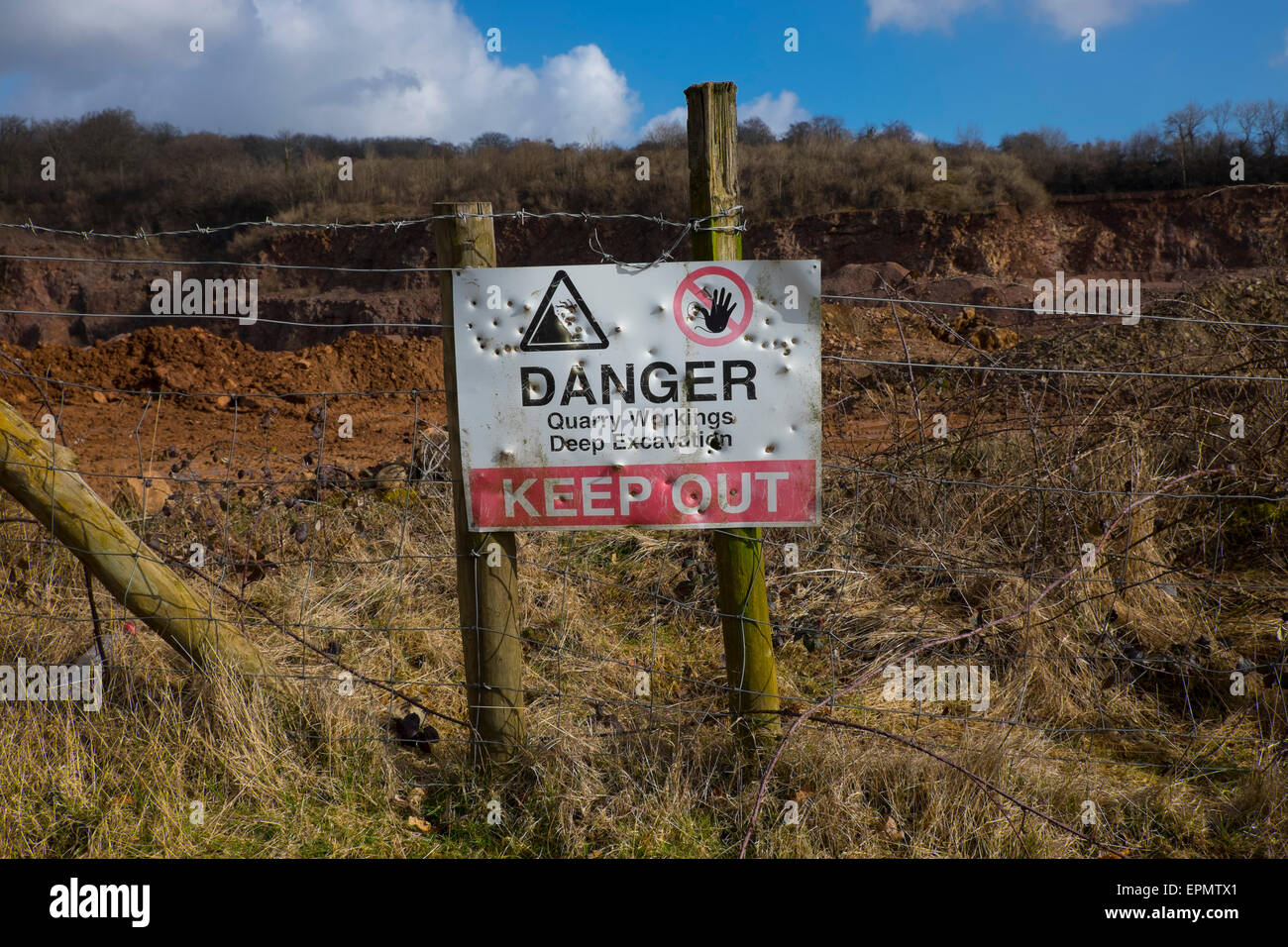 Danger keep out sign on fence surrounding quarry, Pentyrch, South Glamorgan, Cardiff, Wales, UK - Stock Image