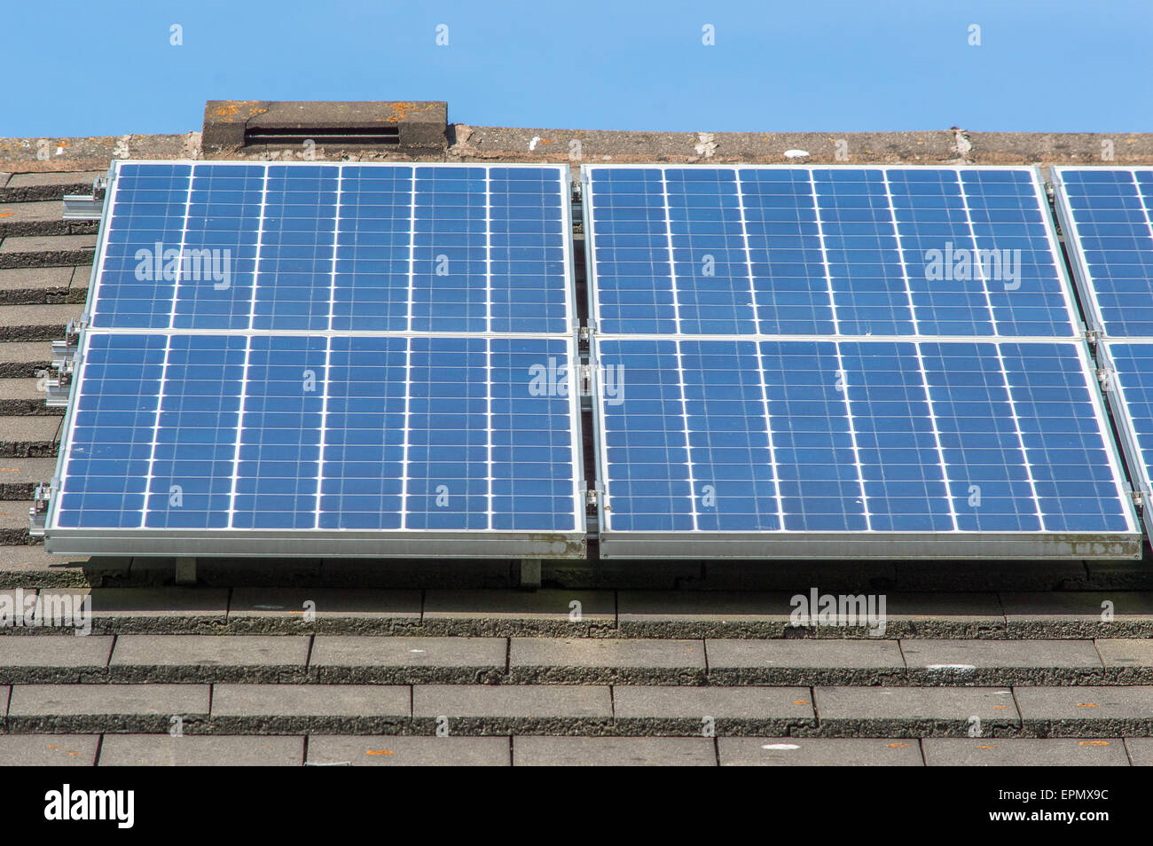 solar panels on a roof on a sunny day - Stock Image