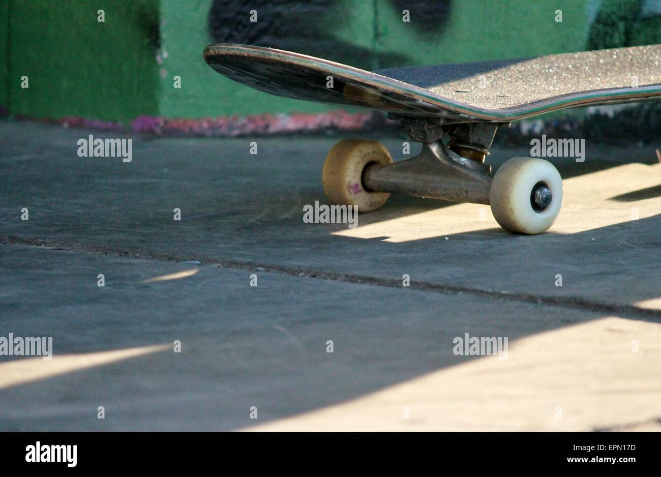 0ba7e1c975 Old used skateboard isolated on the ground. Shallow depth of field.  skateboard, skateboarding, wheels, retro, isolated, dirty,