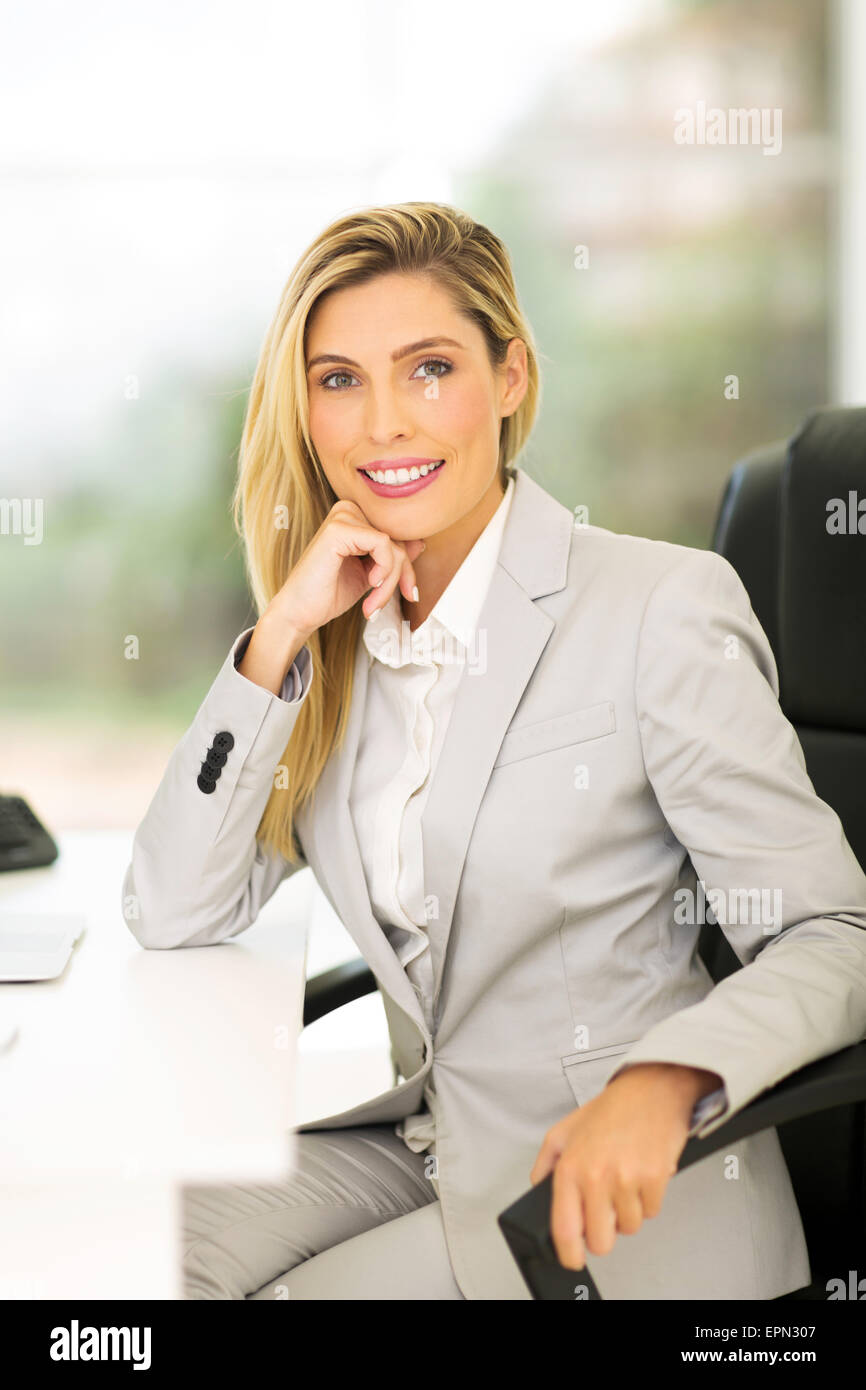 pretty female business executive in modern office - Stock Image
