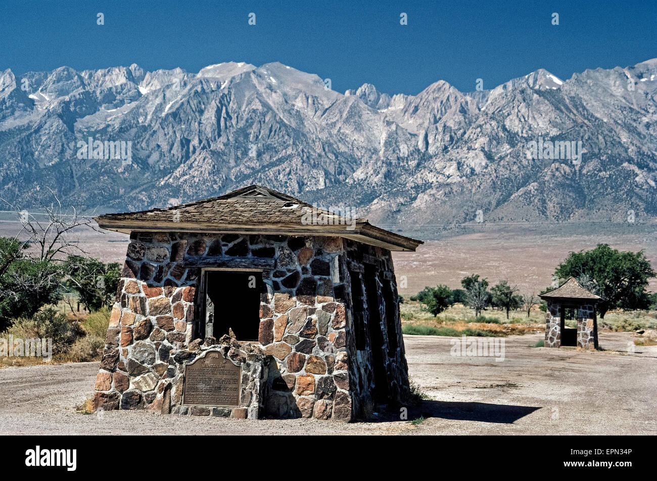 A historical marker is mounted in front of a former sentry post at Manzanar, a World War II relocation camp where - Stock Image