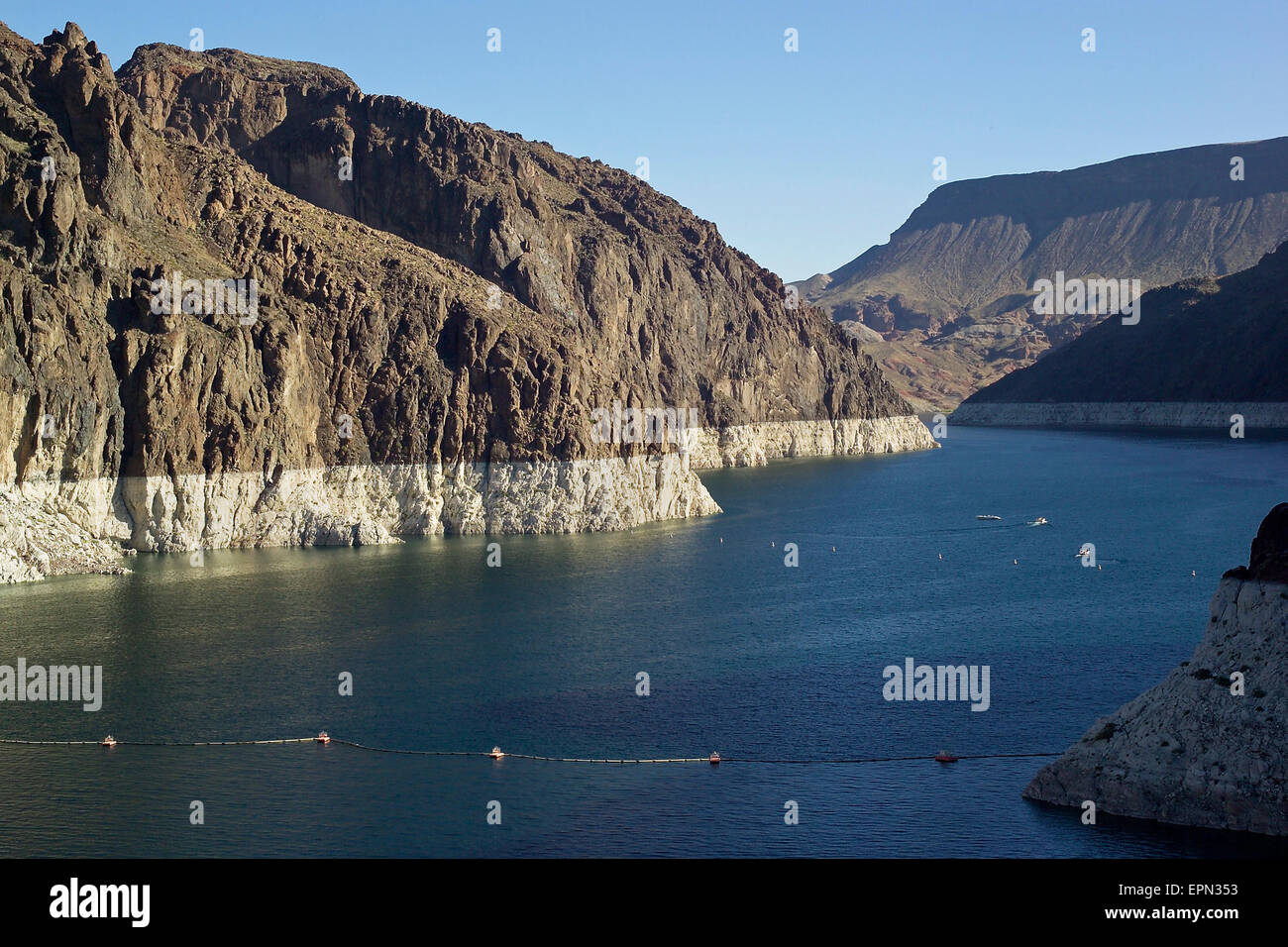 The ongoing drought in the western United States is evident by the lower water line seen on the rock walls that - Stock Image