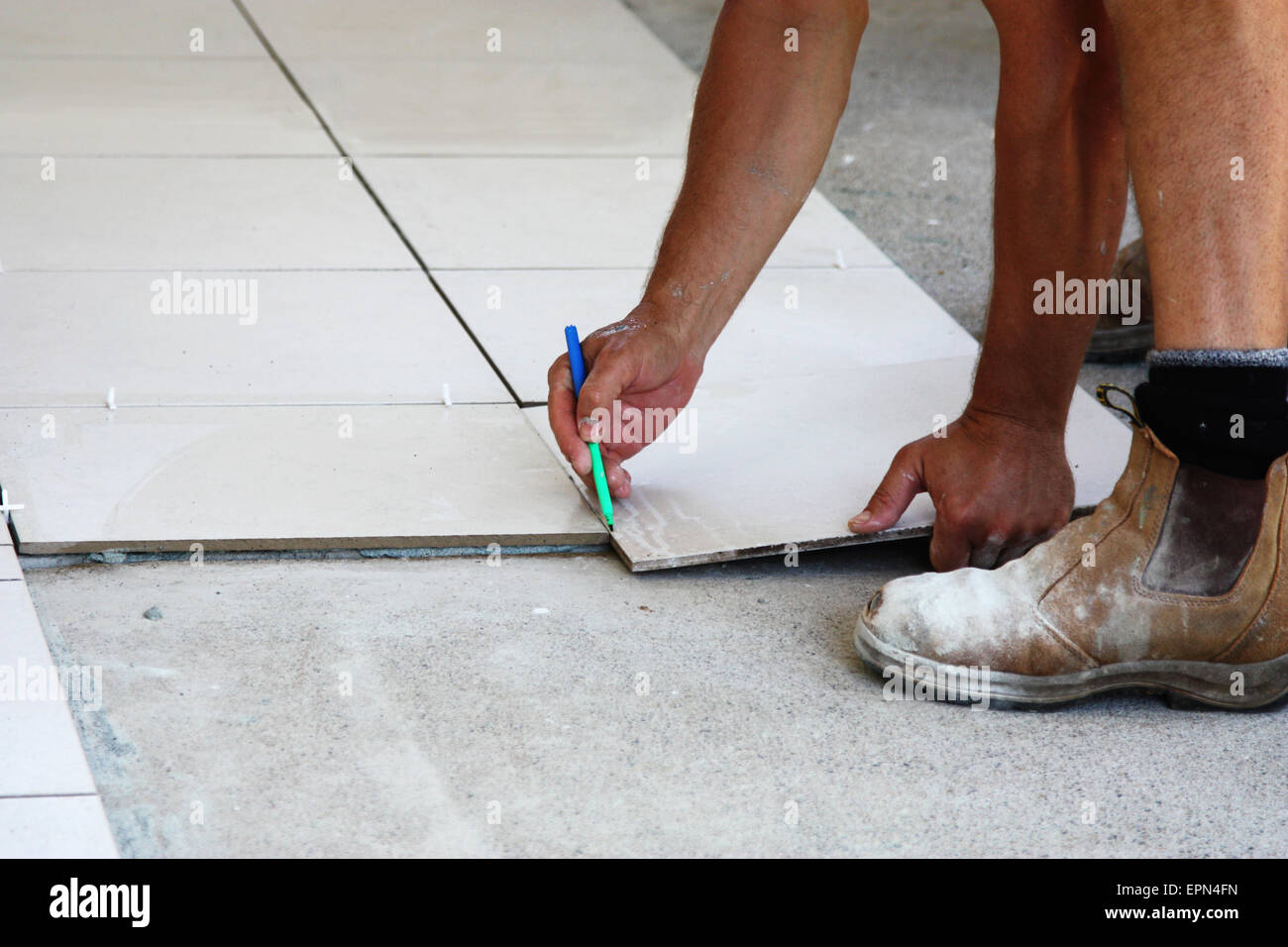 A Male Tile Laying Floor Tiles On A Home Stock Photo 82828473 Alamy