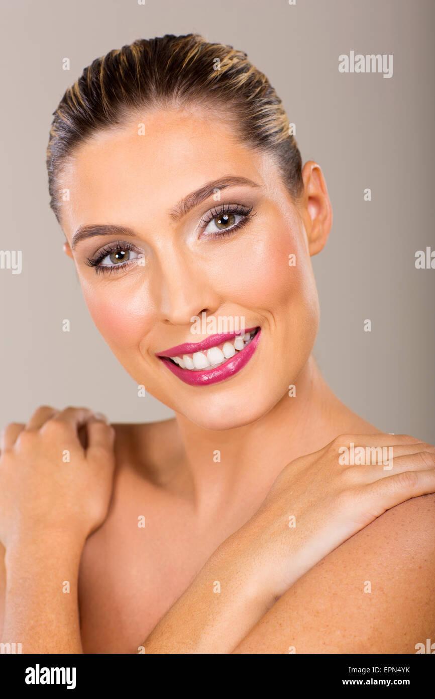 portrait of beautiful woman on plain background - Stock Image