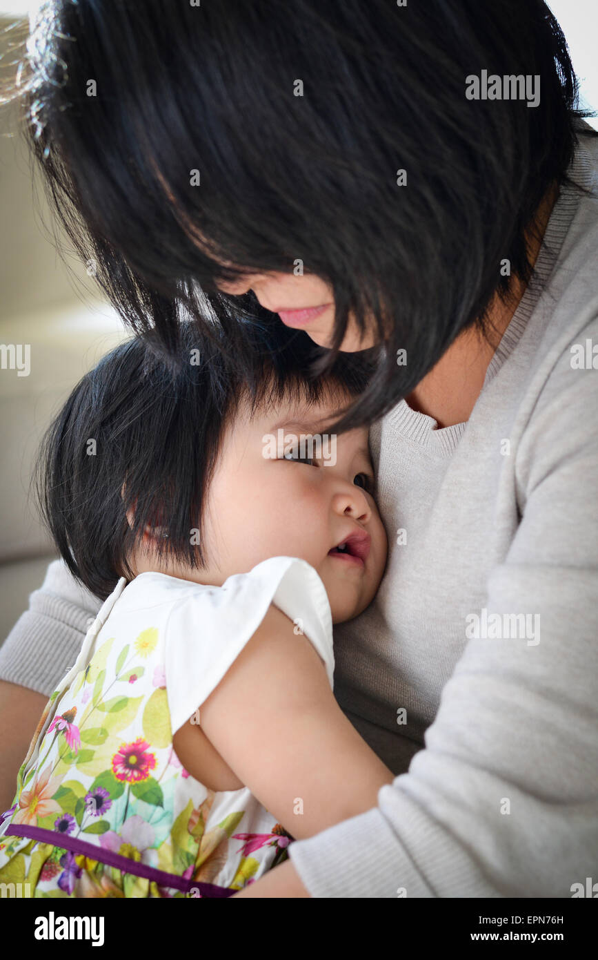 Precious Mother Daughter Moment Of Loving Embrace - Stock Image
