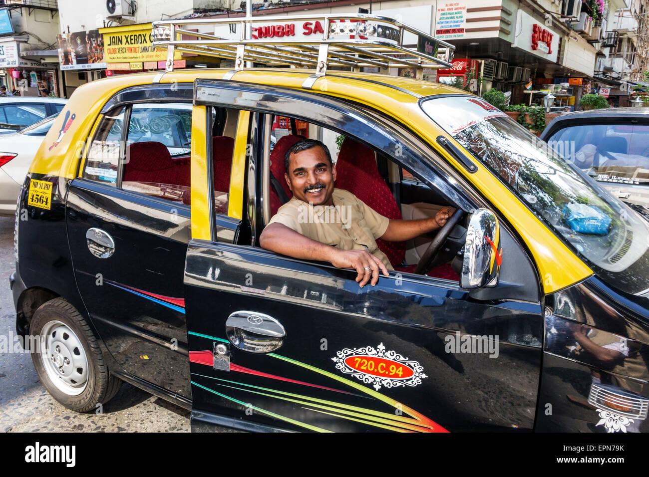 Mumbai India Asian Apollo Bandar Colaba Causeway Market Strand Cinema Road man taxi cab taxis cabs driver job - Stock Image