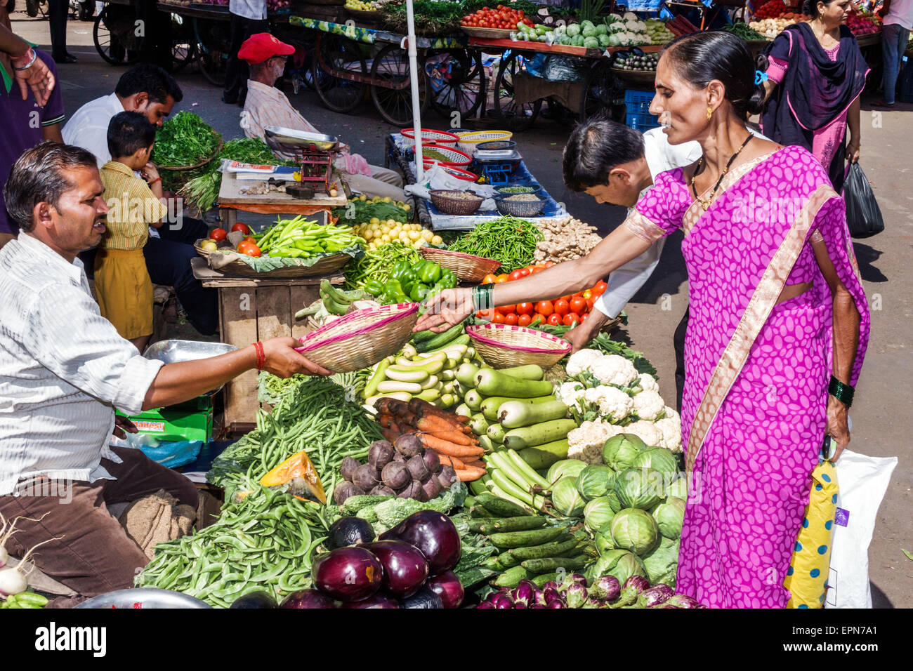 Mumbai India Asian Apollo Bandar Colaba Causeway Market Lala Nigam Road shopping street produce vendor vegetables - Stock Image