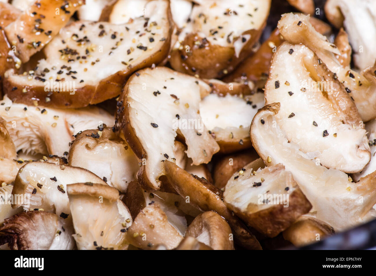 Seasoned sliced mushrooms ready to prepare for cooking - Stock Image