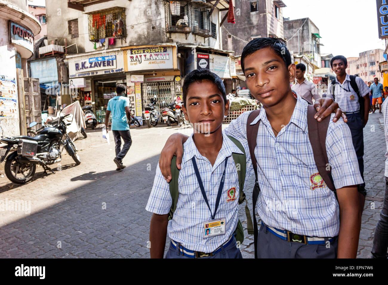 Mumbai India Asian Apollo Bandar Colaba Causeway Market Indumati Sakarikar Marg teen boy friends student school - Stock Image