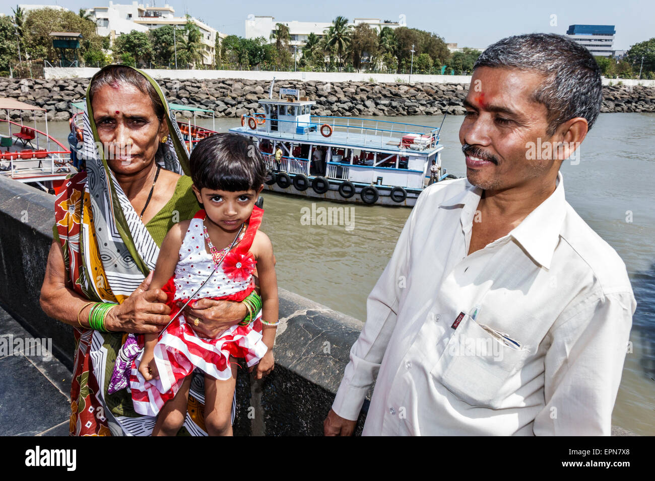 Mumbai India Asian Apollo Bandar Colaba Arabian Sea ferry boat Hindu man grandfather woman grandmother girl granddaughter - Stock Image