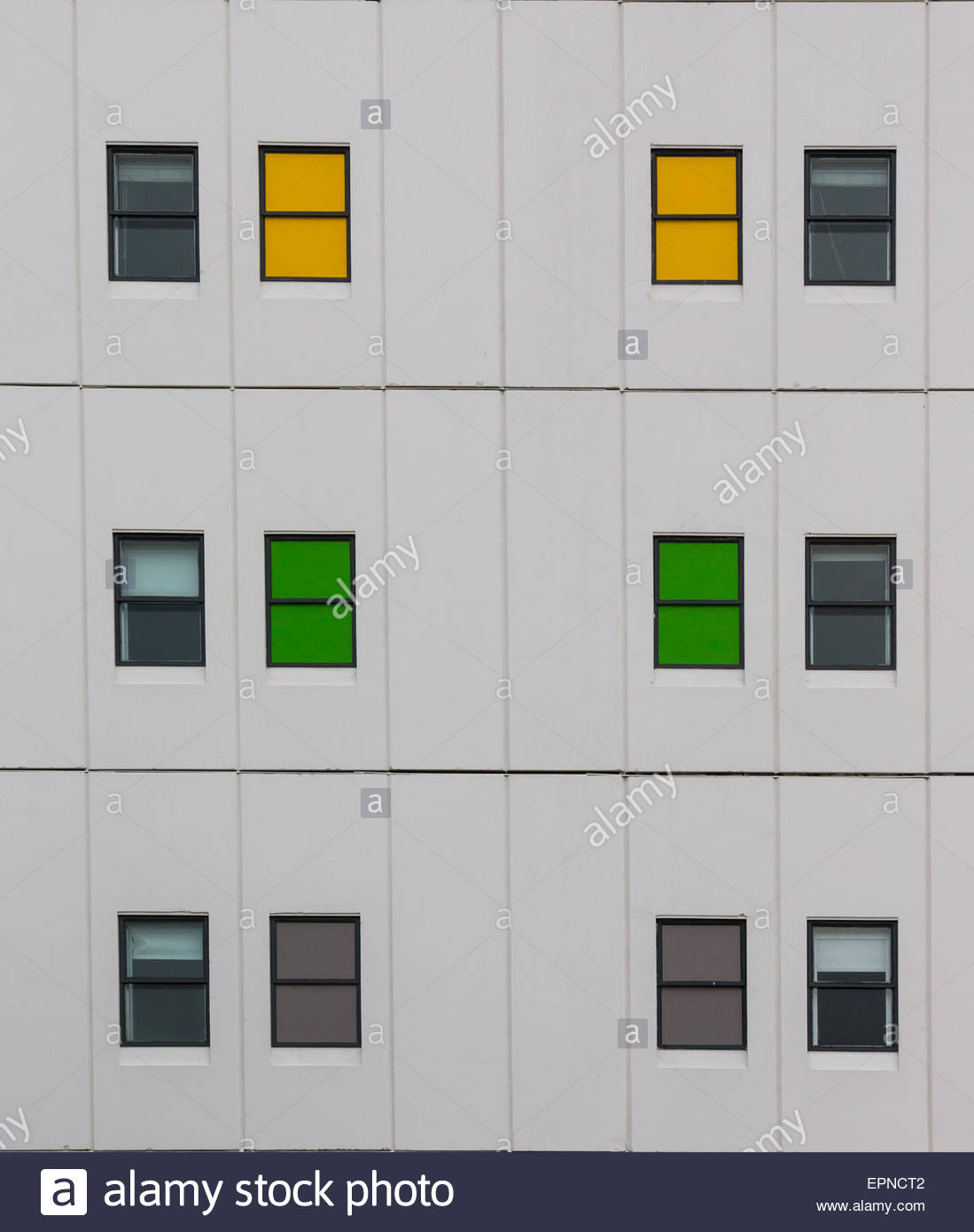Colorful windows of a multistory building - Stock Image